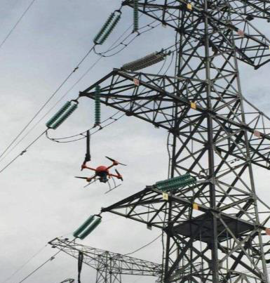A drone inspecting a power grid tower